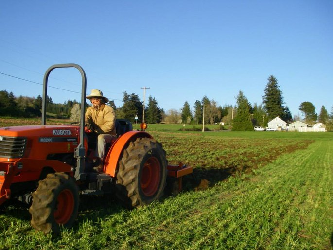 bryan uses the chisel plow to break up the soil on this sunny april day